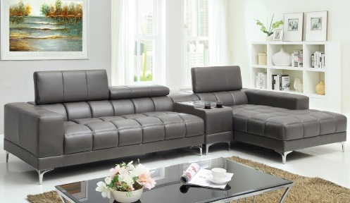 A tufted gray two piece sectional with adjustable headrests and chrome metal legs. In addition to the sectional, a bluetooth console with a subwoofer can be purchased and situated between the two sections for a home theatre.
