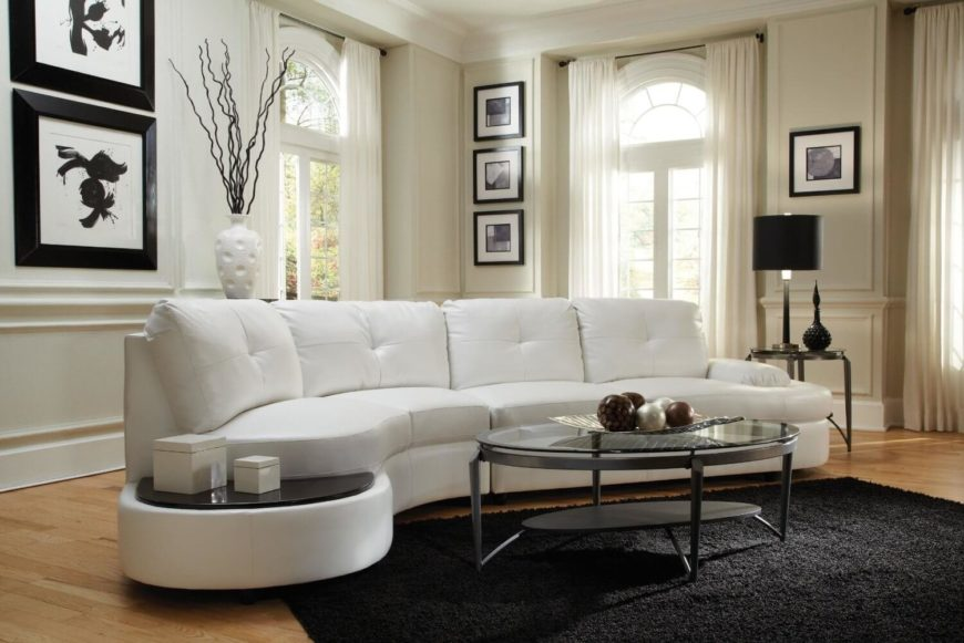 Thick Cushioned Button Tufted White Sectional Here Features Rounded Edges  And A Small Table Like .