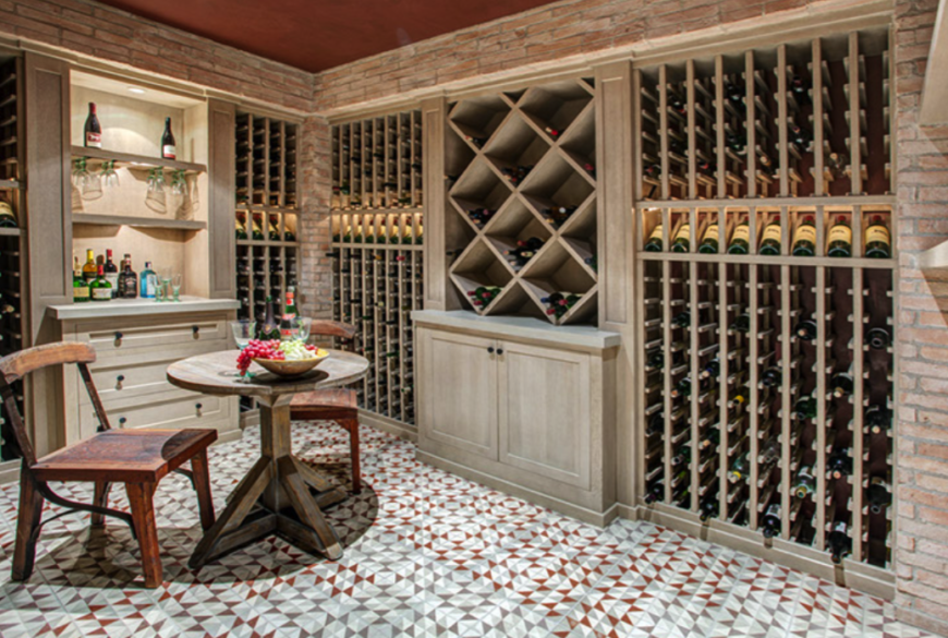 Filling the racks, adding glasses, and a rustic table and chairs completes this space without distracting from the size of the wine cellar.