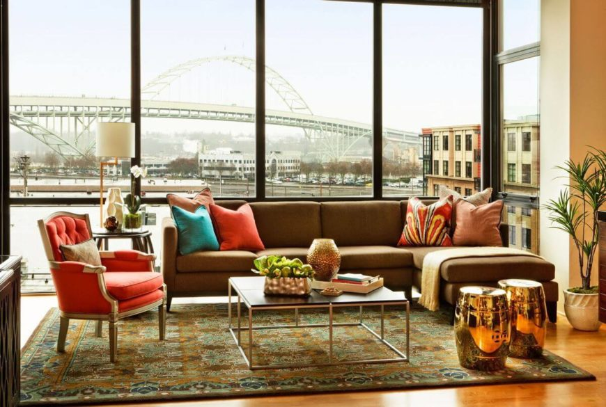 A living room near expansive windows with a bridge view.