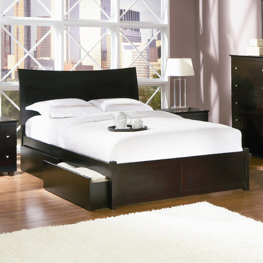 A modern sleigh-style curved headboard with a dark finish and two storage drawers. The bed has an adjustable height setting as well.