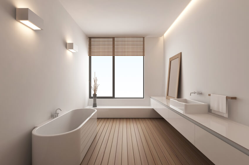 Modern master bathroom featuring a freestanding tub and a vessel sink along with hardwood flooring surrounded by white walls and ceiling.