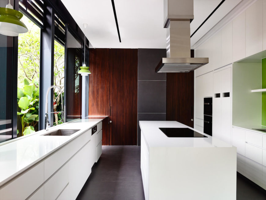 The minimalist kitchen with accents of bright green that bring the outdoors in.