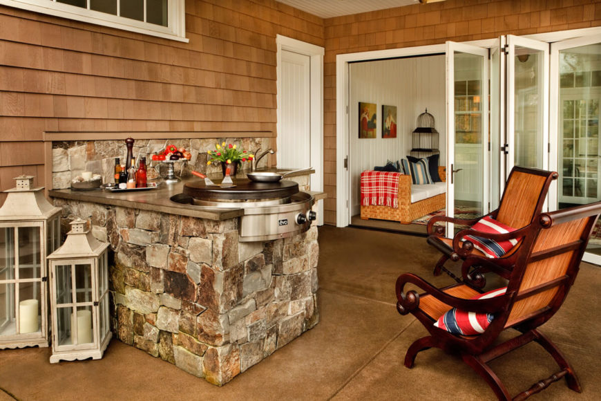 Outside of the spacious sunroom is an outdoor cooking area complete with a fantastic Mongolian grill.