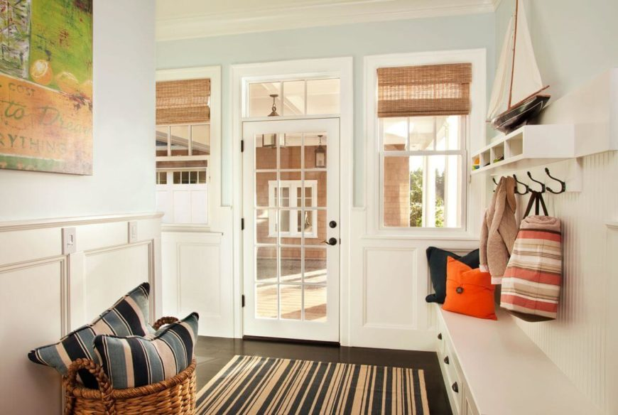 Another, less formal entrance to the home is the mudroom. Storage consists of pull-out drawers and storage hooks.