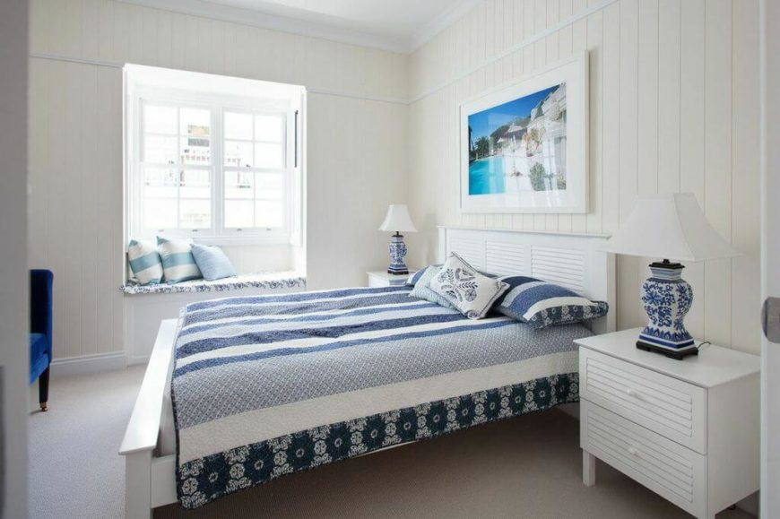 On the main floor are the bedrooms and bathrooms. Continuing the blue designs from the living room and foyer in the master bedroom, the elegant patterns flow throughout the room, from the bedding to the lamps to the window bench seat.