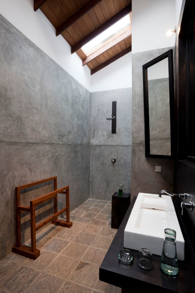 Soaring ceilings make this small bathroom feel