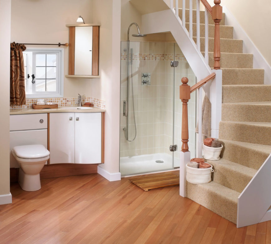This bathroom has a unique entrance from a stairway  A beautiful light hardwood  flooring lines. 26 Master Bathrooms with Wood Floors  PICTURES
