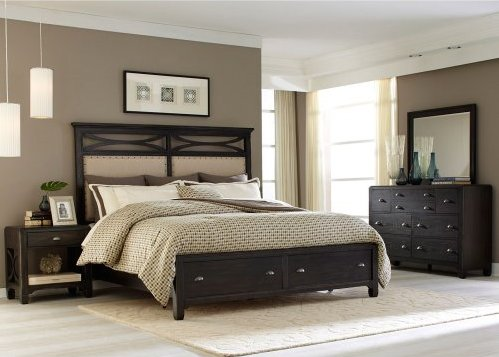"A solid rubber wood with a dark finish. The curved ""x"" design accents of the headboard complement the panels below. Antique pewter nail head trim runs along the perimeter of the panels. The bed has two storage drawers in the footboard"