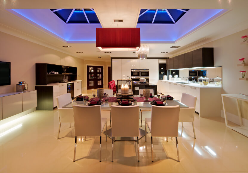 Here we can see the skylights, even at night, do a great job of lighting this kitchen. A cool blue tone is set in the skylights for a great view, even at night.