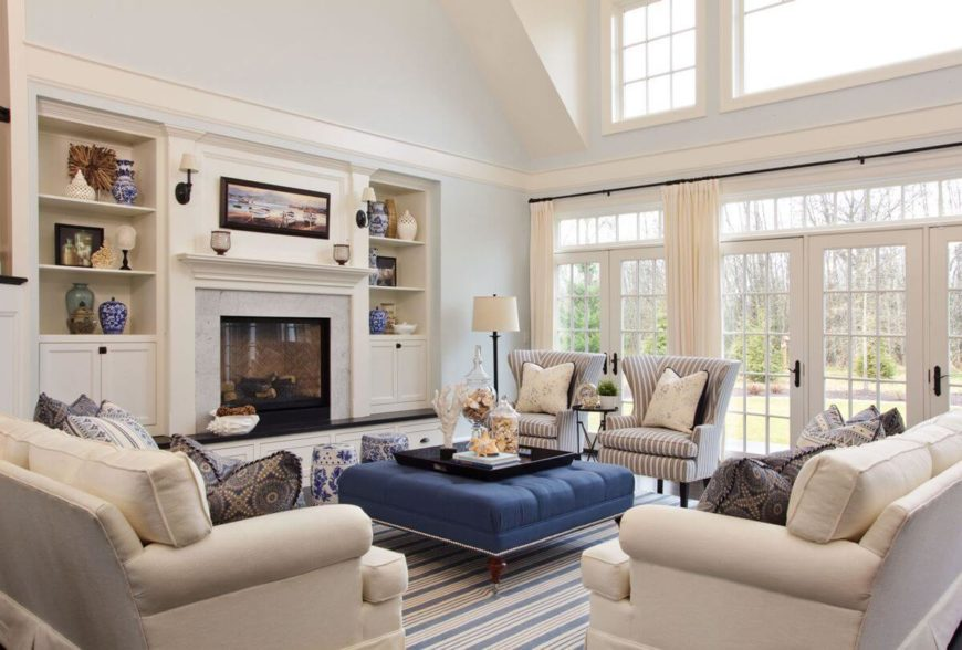 The spacious and bright formal living room has several glass-faced doors topped by transoms. The doors lead out into the beautifully landscaped backyard. The fireplace is flanked by two built-in bookcases on the raised black mantle.