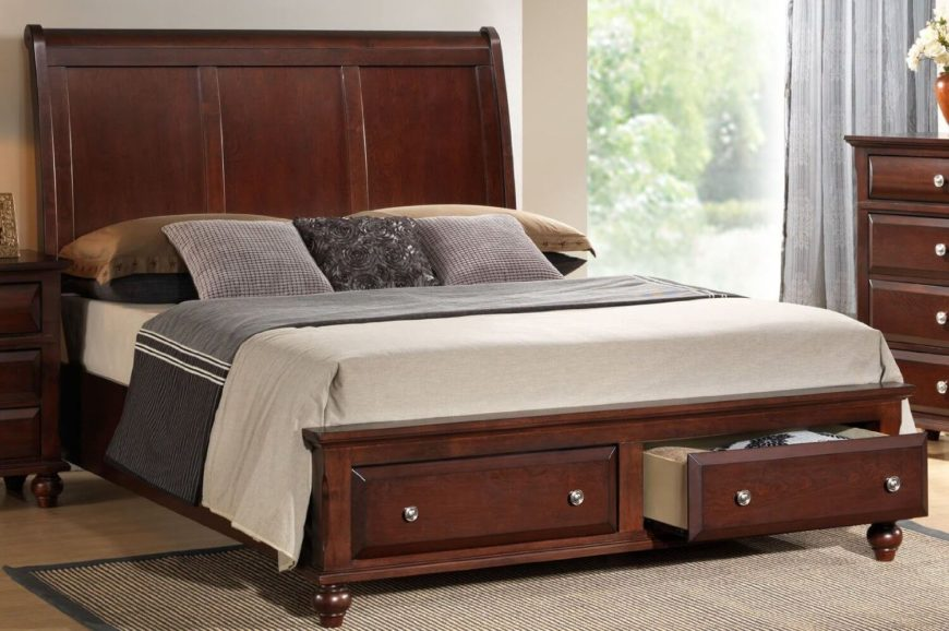 a platform bed with two drawers off of the footboard the frame is a solid