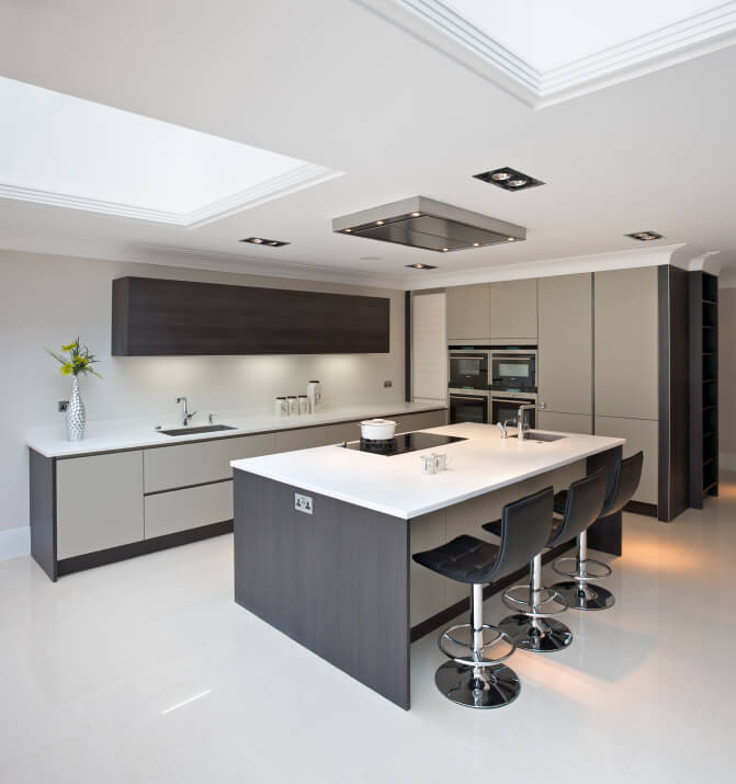 Here is another view of this chic kitchen, where we can see the minimalistic qualities of the furnishing. The skylight brings out the polished look of the floor and countertops.