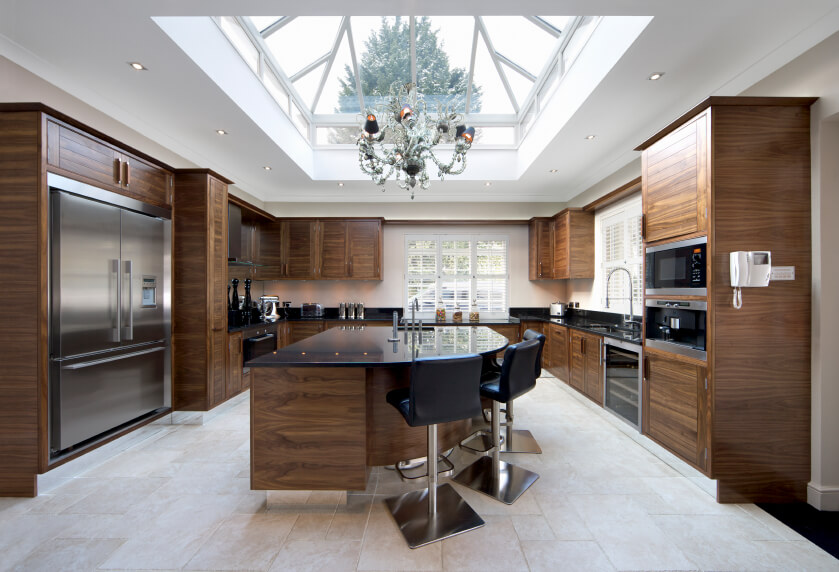 Superieur This Kitchen Is Elegant And Full Of Dramatic Wood Work. A Massive Skylight  Takes Up