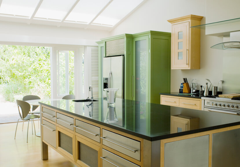Here is the same kitchen from another angle. The natural light really brings together the greens and browns in the cabinets and drawers.