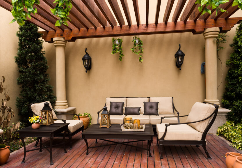 Attirant This Beautiful Covered Deck Is In A Spanish Style, Featuring Hanging Vines  And Sleek Wooden