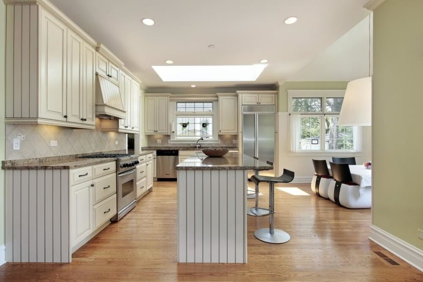 This Contemporary Kitchen Sees Its Light Hardwood Floor And Lengthy Granite  Countertops Glowing Under The Light