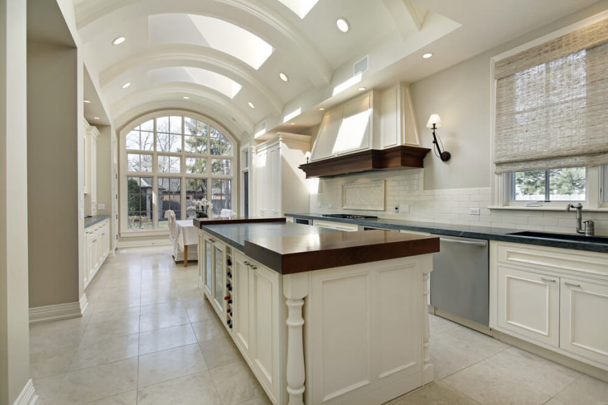 Captivating This Grand, Arched Ceiling Kitchen Features A Multitude Of Skylights,  Naturally Illuminating The Entire