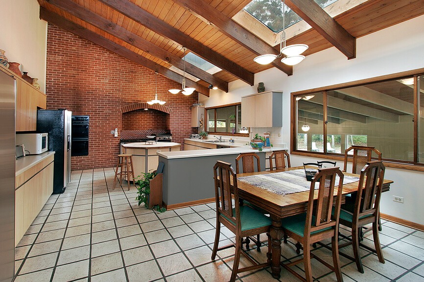 This kitchen combines traditional brick work and natural light hardwood. Skylights move across the ceiling and dapple natural sunlight into the communal area.