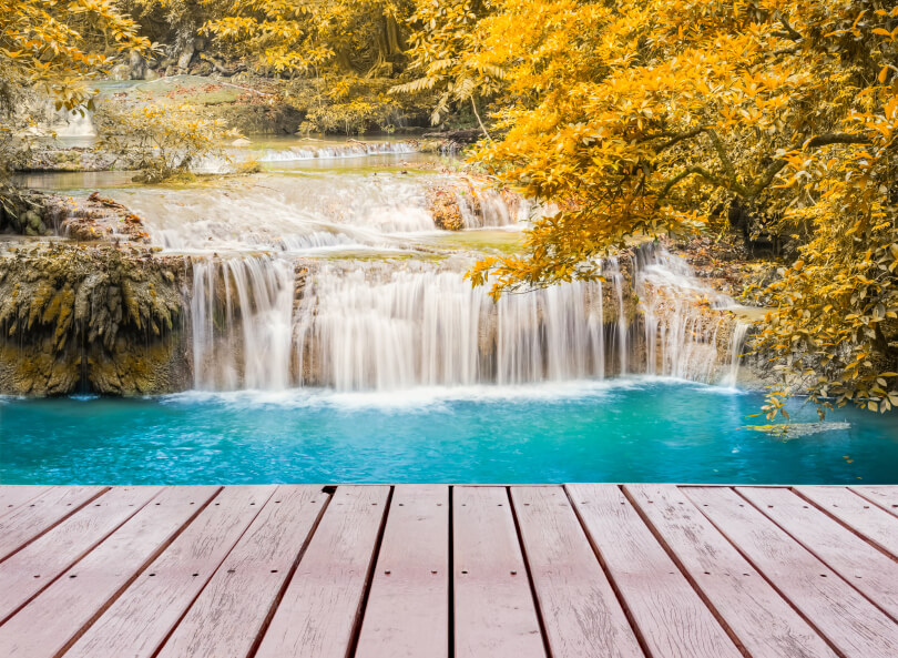 Natural waterfalls as seen from a pier. The pools below are deep enough for swimming.