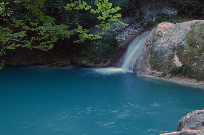 Another natural waterfall with a deep pool for swimming or diving.