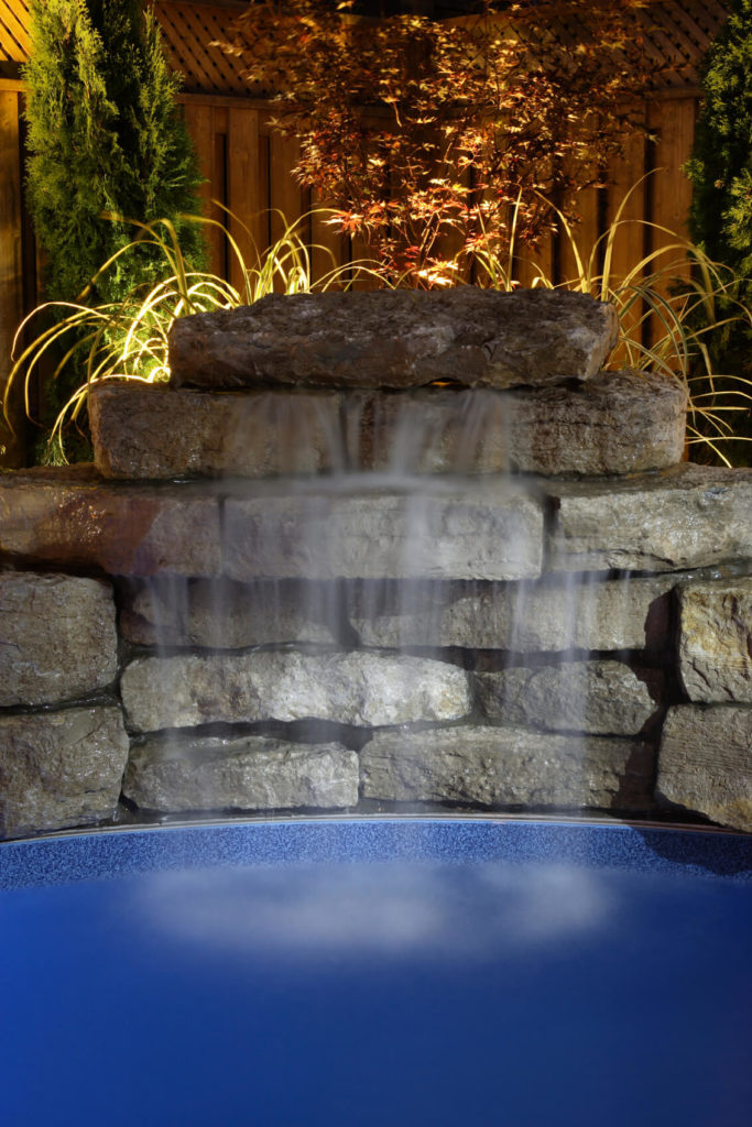 A close up of the above waterfall, showing the layered natural stone.