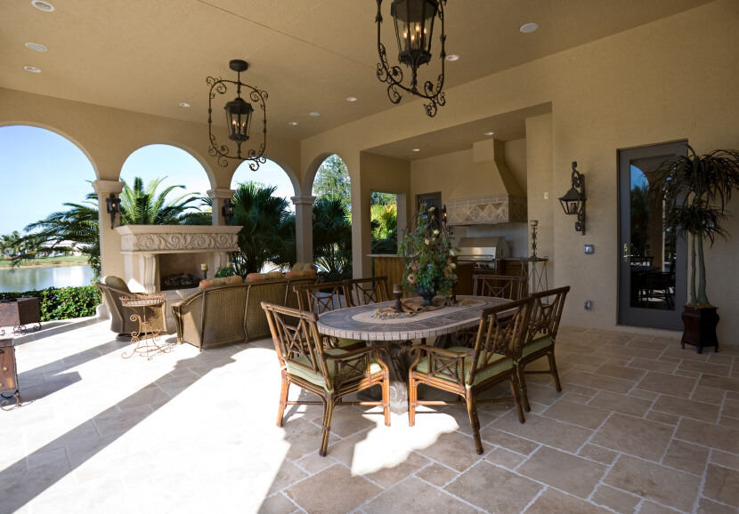This Incredibly Spacious Covered Patio Features A Small Outdoor Kitchen, A  Large Formal Dining Table