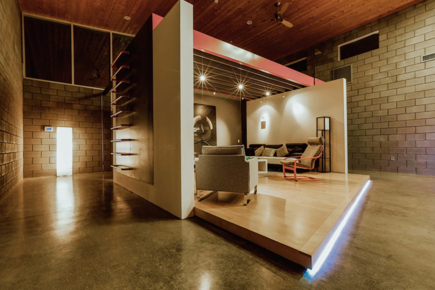 """With its sharply defined edges and under-platform lighting, the """"stage"""" room is truly the defining feature of this home interior."""