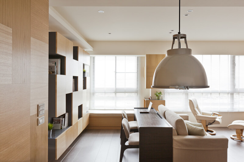Here's a close view of the living room area from the kitchen, with the elegant white and steel pendant light in foreground.