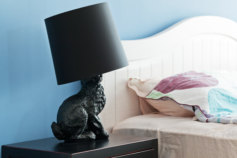 Little idiosyncratic touches, like this black bunny lamp, lighten the mood of the minimalist home.