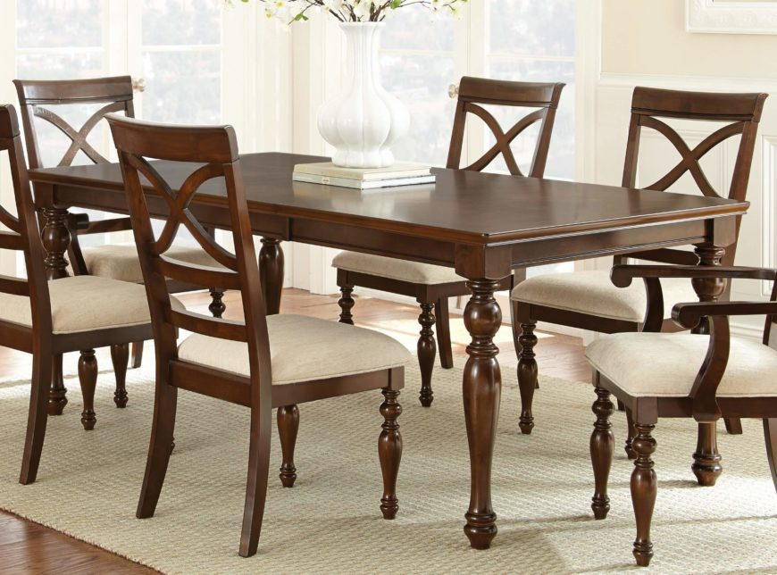This Traditionally Styled Dining Room Table Features Ornate, Carved Legs  With An Arrow Foot Design
