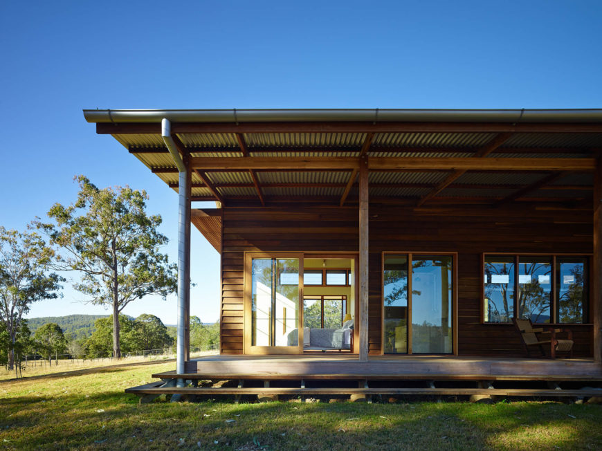A lengthy veranda runs the length of the home, connected to various interior rooms via sliding glass doors along the way. With a large overhanging roof, shade and protection from the elements is provided.