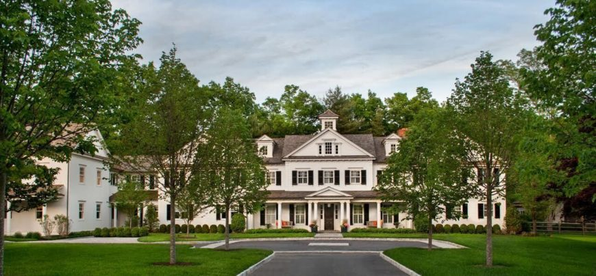 Stately exterior with beautiful landscaping.