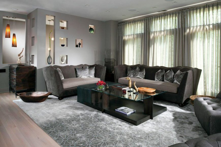 A grand living room in gray with two tiers of curtains.