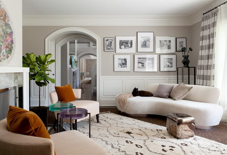 A Beautiful Contemporary Living Room Featuring Two Small End Tables, Each  With A Different Colored