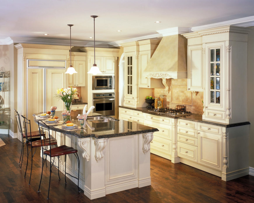 This kitchen is very elegant and gorgeous. The natural hardwood flooring and rustic vent hood keep this kitchen very traditional and luxurious.