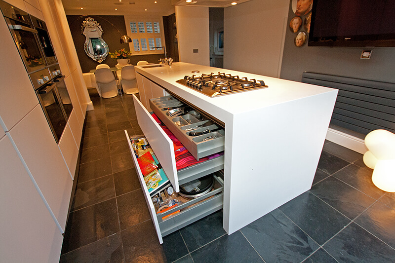 With the extra-large drawers opened, we see the massive and efficient storage options within the island.