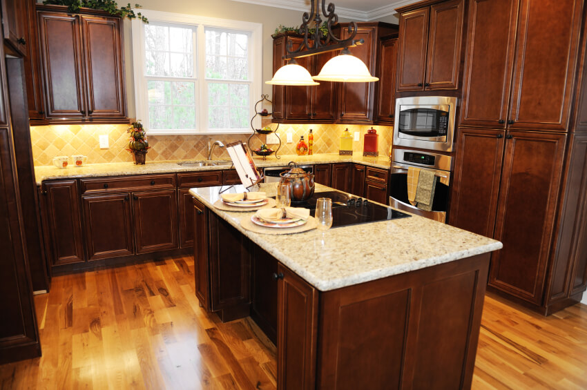 This Sharp Kitchen Utilizes The Light Wood Floor Bright Backsplash And White Countertops To