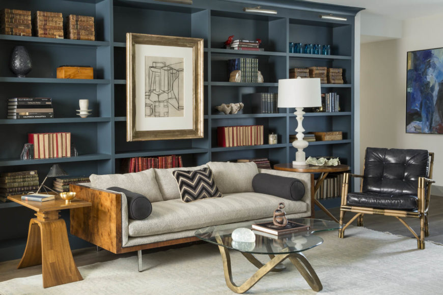 A Bold And Masculine Living Room With Large Built In Blue Bookcases Behind  The Wood