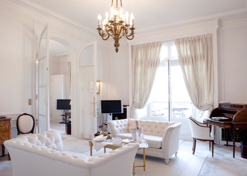 In A Mostly White Living Room, Sheer Curtains In A Slightly More Neutral  Shade Are