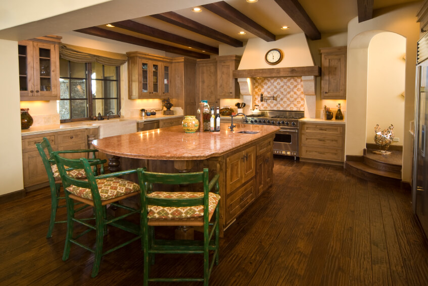 This Large Kitchen Has A Gorgeous Vent Hood And A Island With A Table  Extension.