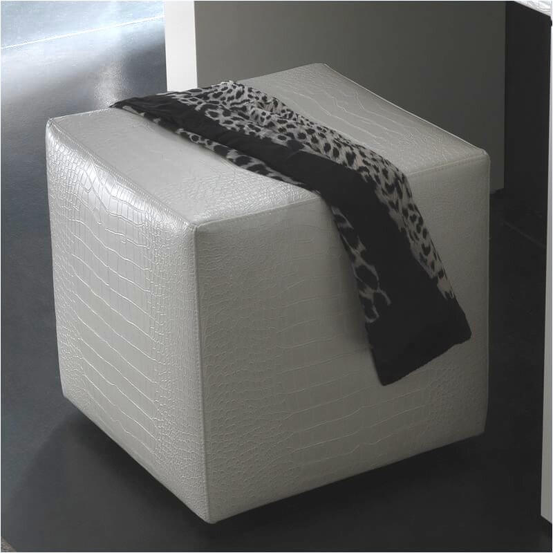 A soft pouf that can double as a footrest or ottoman in Italian leather with a crocodile texture.