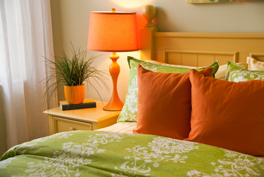 Orange and greens play perfectly against each other in this fun and bold arrangement.