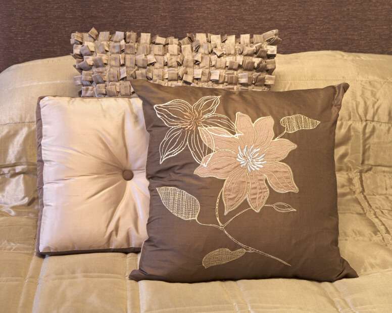 Diversity in texture and patterns make this simple arrangement of accent pillows truly exceptional. Against the neutral beige canvas of the bedding, this grouping stands out beautifully.