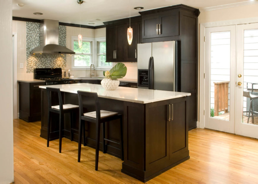 The Bright Simple Kitchen Is Weighted By Use Of Dark Cabinets Tile