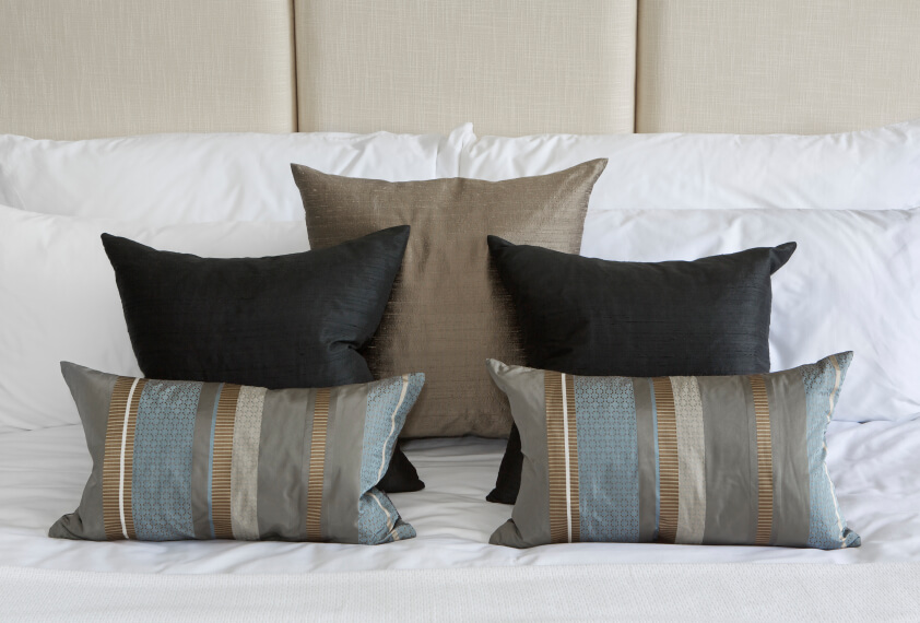 An experiment in symmetry demonstrates how thoughtfully arranged accent pillows can make a real impact within any decor.