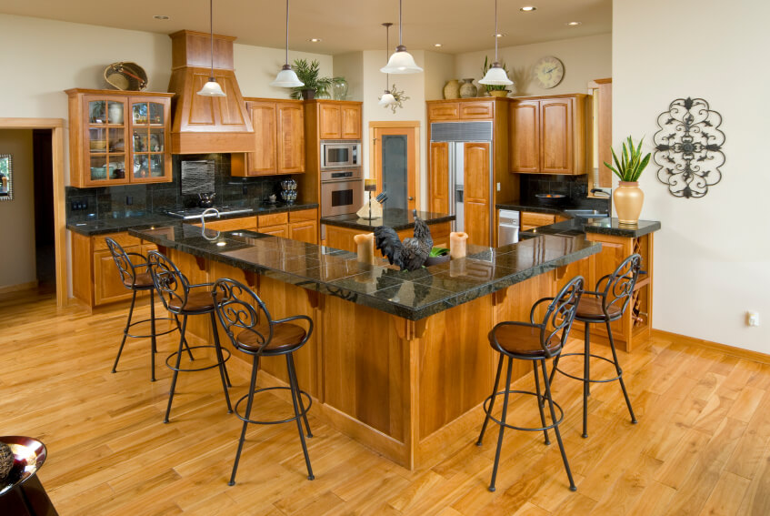 The Bright Wood Of This Kitchen Help To Keep The Dark Countertops From Becoming Overbearing In