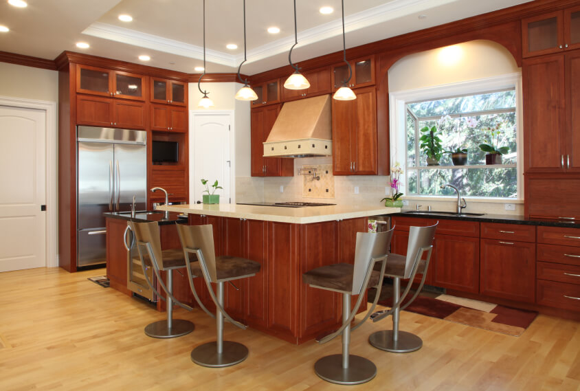 The Lovely Warm Kitchen Is Brightened Up By The Use Of The Light Wood Floor  And
