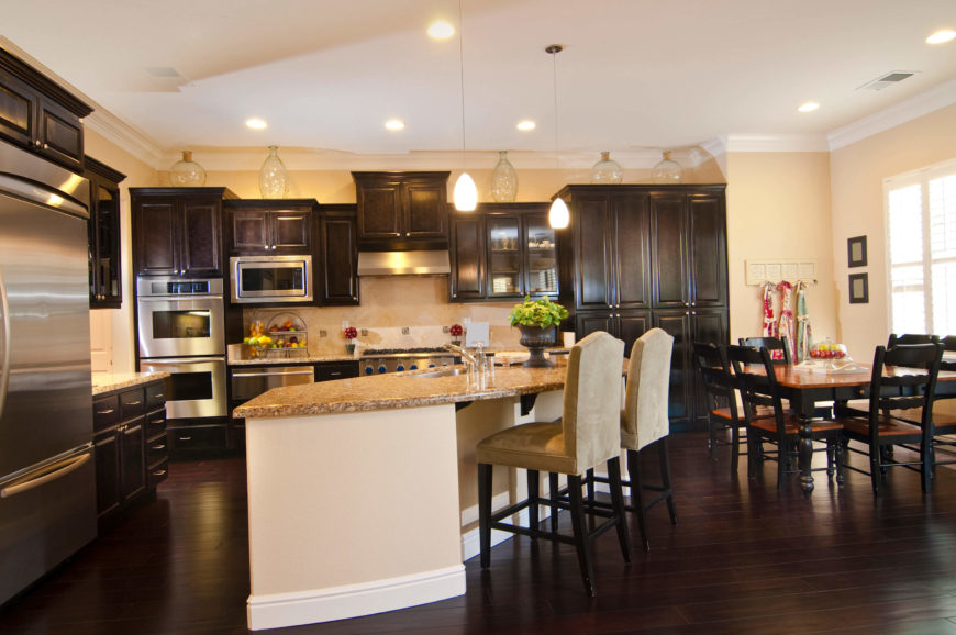 This Fantastic Kitchen Has A Sleek Dark Wooden Floor The Cabinets In This Space Correspond