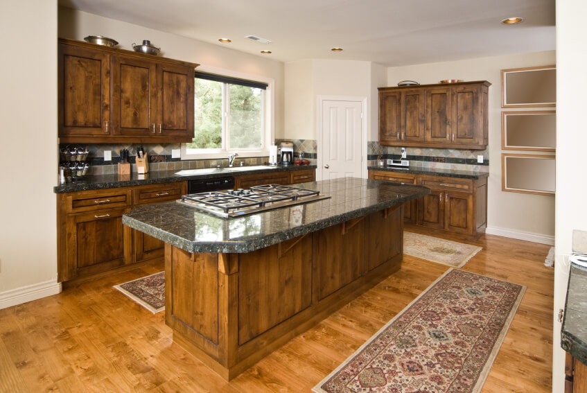 Perfect The Gorgeous Natural Wood Of These Dark Cabinets Complements The Textures  In The Lighter Wood Flooring